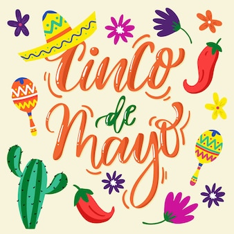 Cinco de mayo schriftzug mit verschiedenen mexikanischen elementen