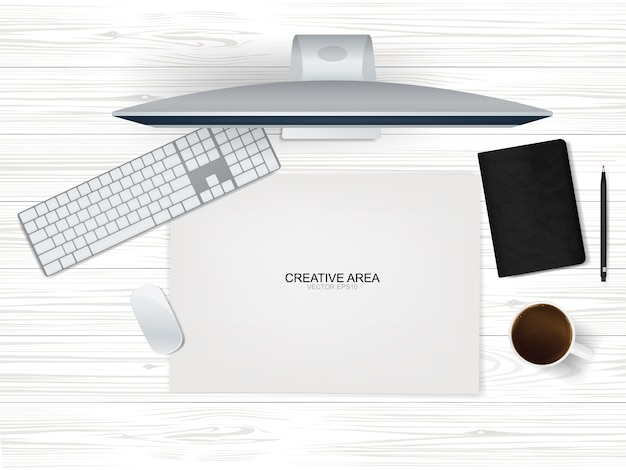 Computeranzeigehintergrund des arbeitsraums mit büroobjekt auf holz