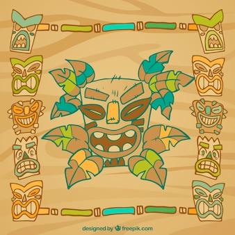 Cooler und bunter rahmen mit tiki masken und bambus