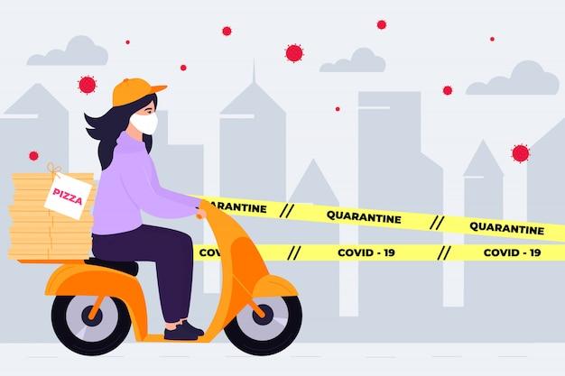 Covid19. quarantäne in der stadt. coronavirus epidemie. liefermädchen in einer schutzmaske trägt pizza auf einem fahrrad