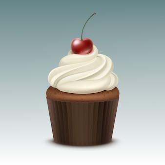 Cupcake mit weißer schlagsahne und kirsche nahaufnahme