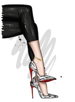 Damenbeine in stylischen hosen und schuhen