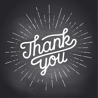 Danke, handbeschriftung danke mit sunburst vintage kreidegrafik auf schwarzem tafelhintergrund.