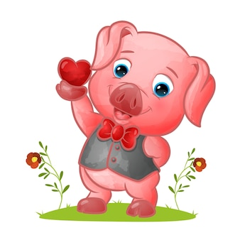 Das aufgeräumte schweinchen mit weste und schleife hält eine kleine liebe zur illustration