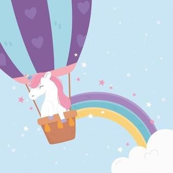 Das einhorn, das heißluftballon fliegt, spielt niedliche cartoonillustration des magischen traums der regenbogenphantasie die hauptrolle