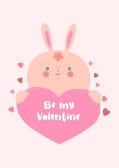 Das kaninchen hält das herz. valentinstagskarte.