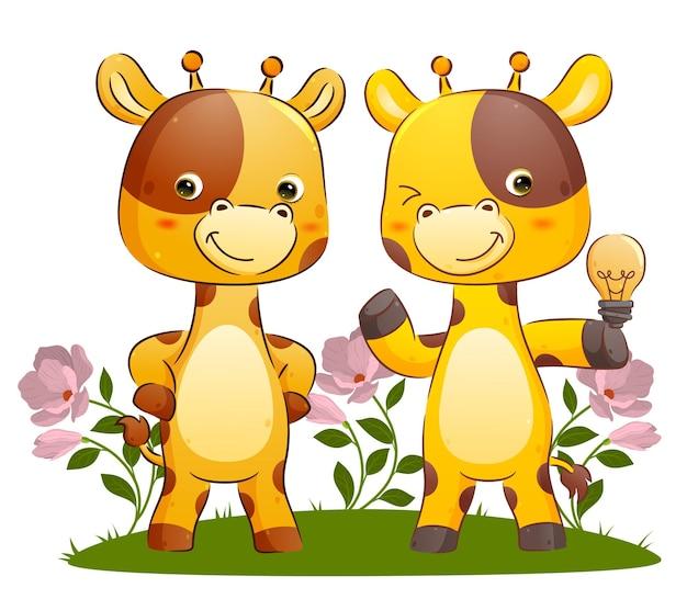 Das kluge giraffenpaar hält eine lampe, weil es eine gute idee für die illustration hat