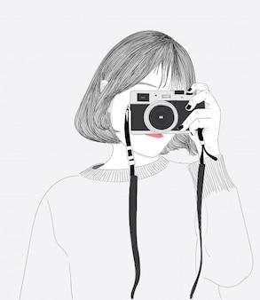 Das kurzhaarige Mädchen macht selbst ein Foto