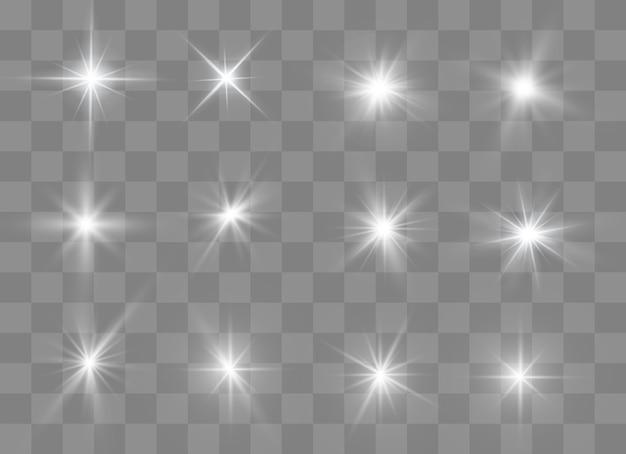 Das licht eines sterns. sterne leuchten auf einem transparenten hintergrund explodiert auf einem transparenten hintergrund. weißes licht.