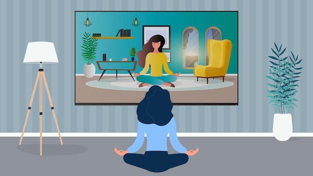 Das mädchen beschäftigt sich mit geführter meditation. frau, die meditationsstunde im fernsehen beobachtet.