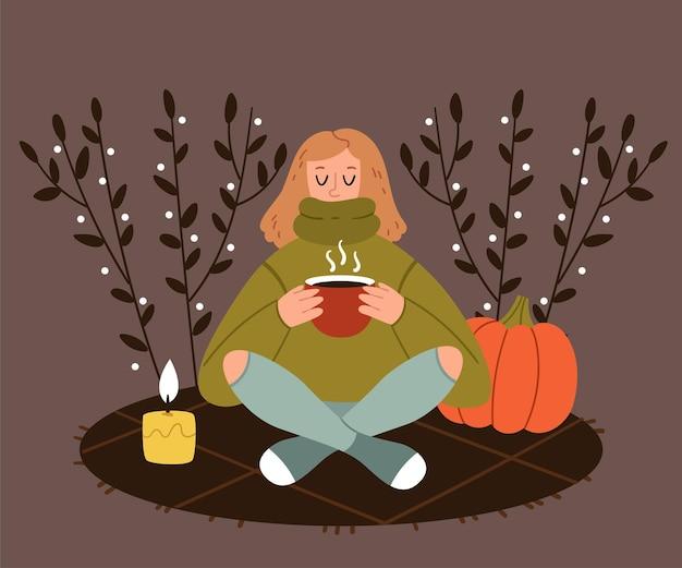 Das mädchen im herbstpark trinkt kaffee tee kakao herbstpicknick romantische atmosphäre