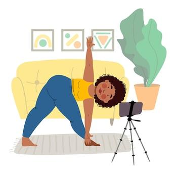 Das mädchen nimmt online-kurse am telefon, macht yoga. das konzept von bleiben sie zu hause.
