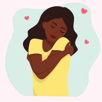 Das mädchen umarmt sich. dich selbst lieben.