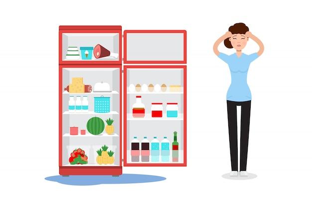 Defekter kühlschrank und traurige frau mit dort.