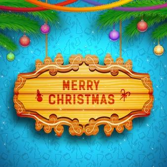 Dekorative grußkarte mit holzbrett-tannenzweigbändern weihnachtskugeln auf blau