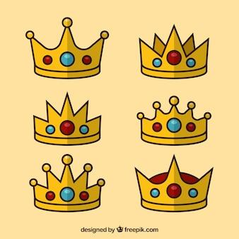 Dekorative kronen mit blauen und roten edelsteinen