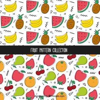 Dekorative muster mit handgezeichneten früchten