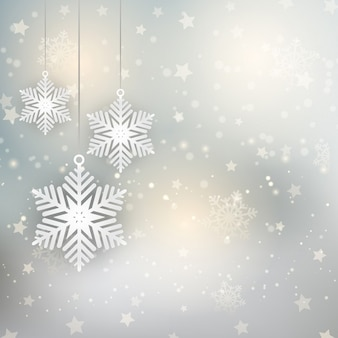 Dekorative weihnachten hintergrund mit hängenden schneeflocken