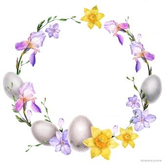 Dekorativer aquarellkranz mit blumen und eiern