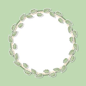 Dekorativer blumenrahmen mit grünen blättern.