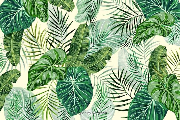 Dekorativer hintergrund der grünen tropischen blätter