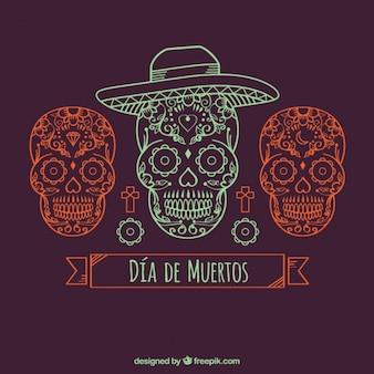 Dekorativer hintergrund mit drei hand gezeichneten mexikanischen schädel