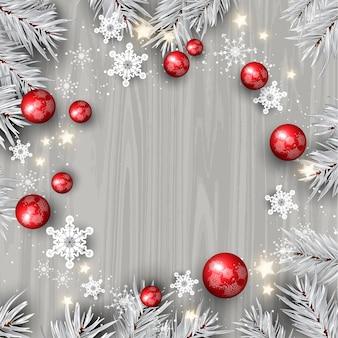 Dekorativer weihnachtshintergrund mit dekorationen auf einer hölzernen beschaffenheit