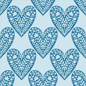 Dekoratives blumenherzmuster. moderner hintergrund des valentinsgrußes in den blauen farben.