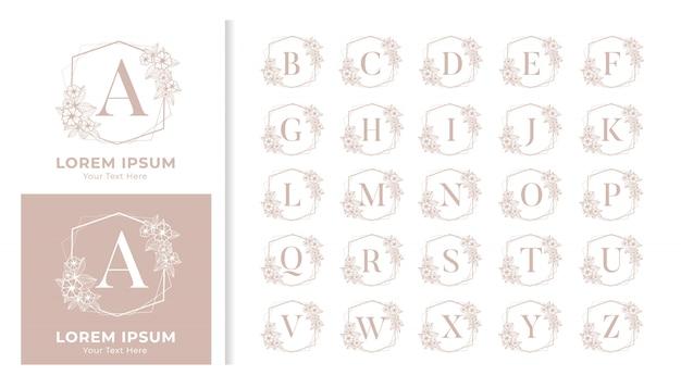 Dekoratives luxus-alphabet-monogramm mit blumenrahmen