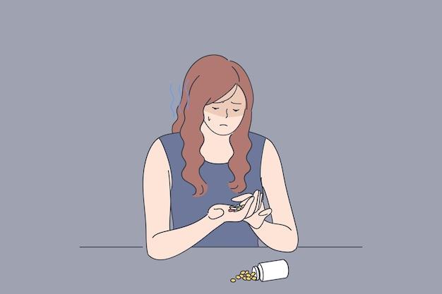 Depression, stress, trauer konzept. junge verärgerte frauenkarikaturfigur, die mit pillen und medizinischen drogen sitzt und an tödlicher krankheit leidet