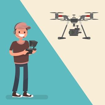 Der bediener steuert den quadrocopter mit einer professionellen kamera. nahaufnahmen aus der luft machen.