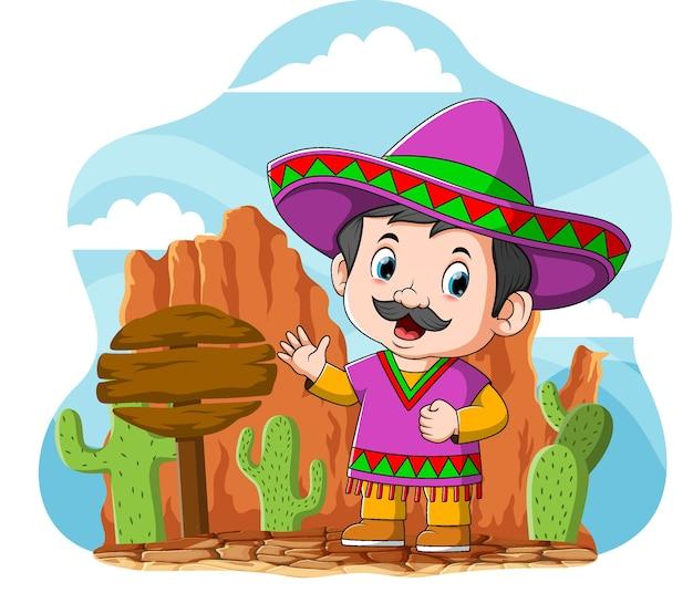 Der cartoon des mexikanischen onkels, der nahe dem straßenschild und dem kaktus steht