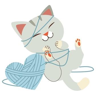 Der charakter der niedlichen katze, die mit garn im flachen vektorstil spielt.