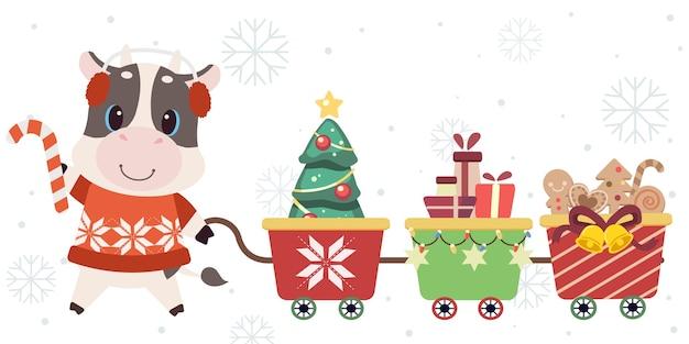 Der charakter der niedlichen kuh mit weihnachtszugspielzeug