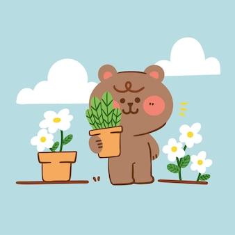 Der entzückende stolze teddybär zeigt sein pflanzengekritzel