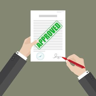 Der geschäftsmann hält das genehmigte dokument mit der linken hand und unterschreibt es mit der rechten hand.
