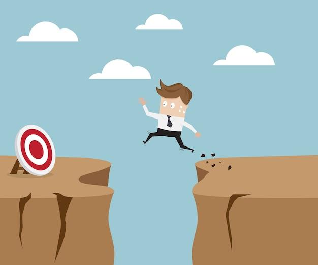 Der geschäftsmann springend über klippe zum ziel