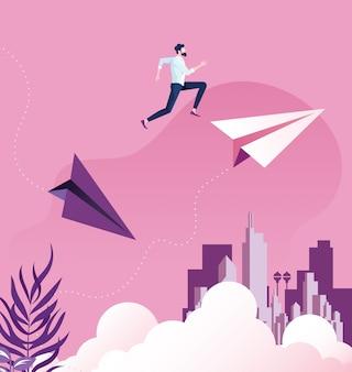 Der geschäftsmann springend zwischen papierflugzeuge