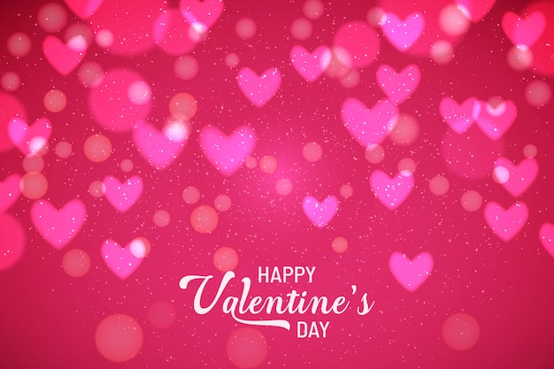 Der hintergrund des valentinsgrußes mit unscharfen herzen
