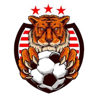 Der kopf des tigers hält einen fußball für den fußballverein