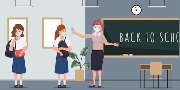 Der lehrer überprüft die körpertemperatur, bevor der unterricht beginnt. zurück zur schule in quarantäne.