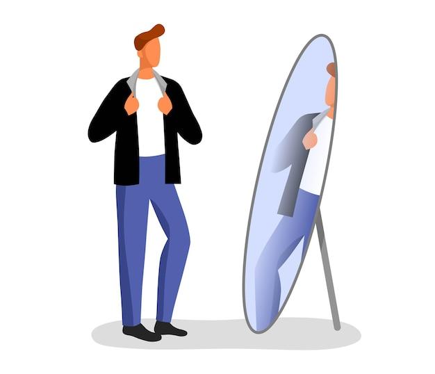 Der mann probiert kleider an. herbst einkaufen. schaut in den spiegel im laden