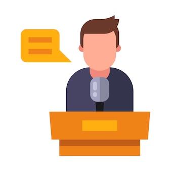 Der sprecher hält eine rede hinter dem podium.