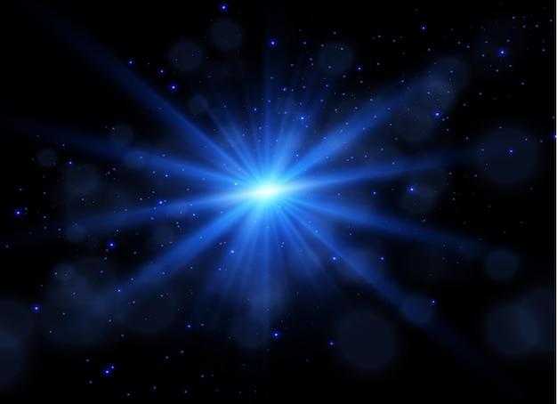 Der staub ist blau, blaue funken und blaue sterne leuchten mit speziellem licht funkelnde magische staubpartikel