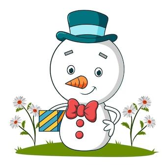Der süße schneemann hält eine geschenkbox mit illustration
