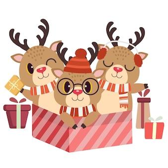 Der weihnachtscharakter von niedlichen hirschen und freunden in der großen gifbox in der flachen artillustration Premium Vektoren