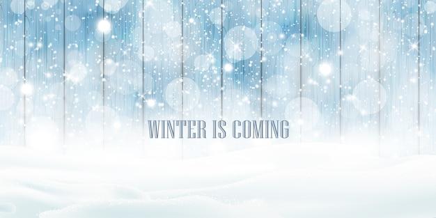 Der winter kommt, inschrift über starkem schneefall, schneeflocken schneeverwehungen. winterlandschaft mit fallendem glänzendem schönen schnee.