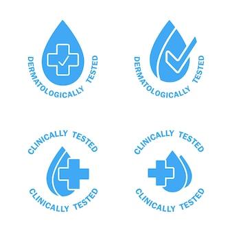 Dermatologisch und klinisch getestete symbole blaue etiketten mit wassertropfen und medizinischem kreuz