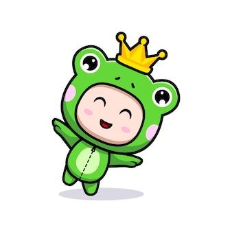 Design eines süßen jungen mit froschkostüm, der mit krone spielt