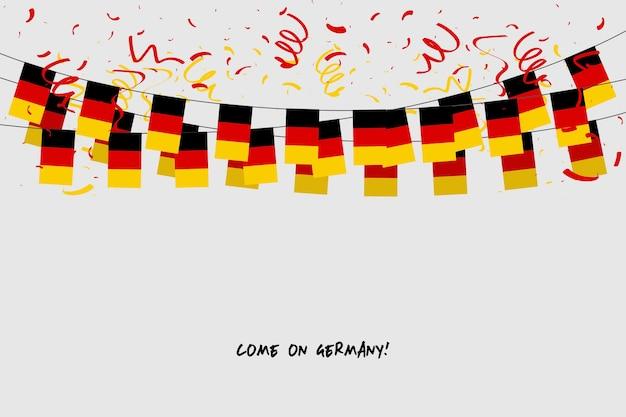 Deutschland-girlandenflagge mit konfettis auf grauem hintergrund.